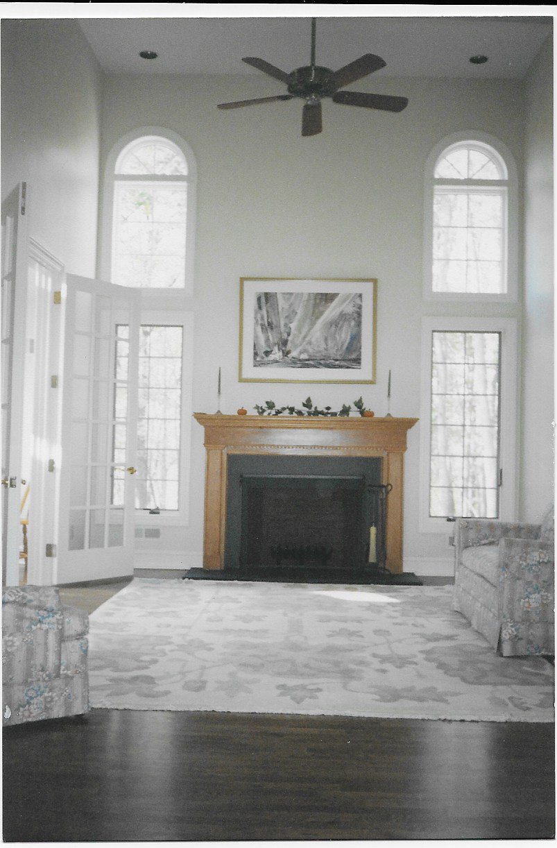 Living room with high ceiling and fireplace