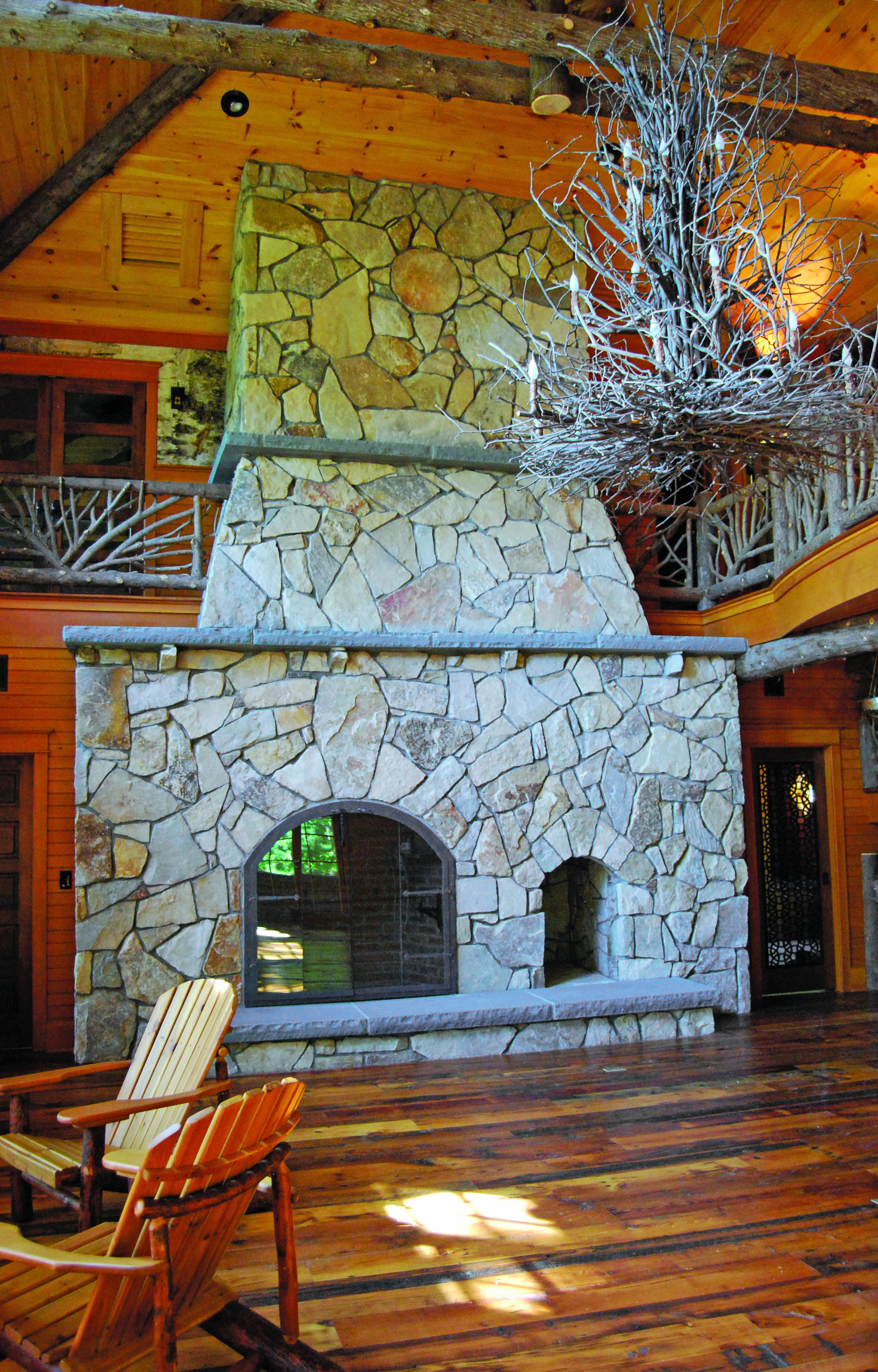 Stone style fireplace and stylish chandelier