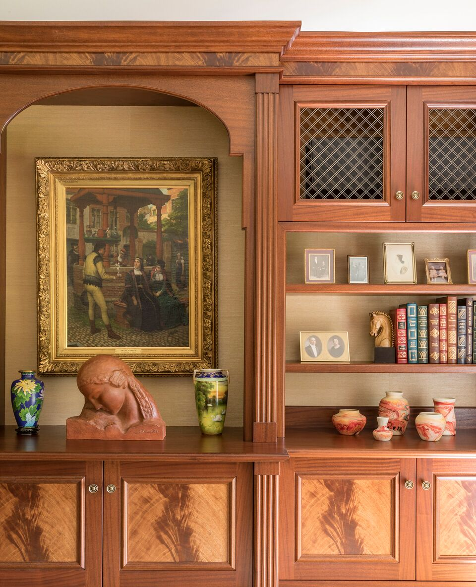 Wooden cabinet with painting and books