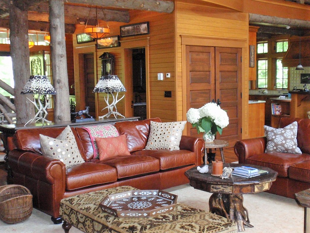 Wooden style living room with leather sofa and stylish center table