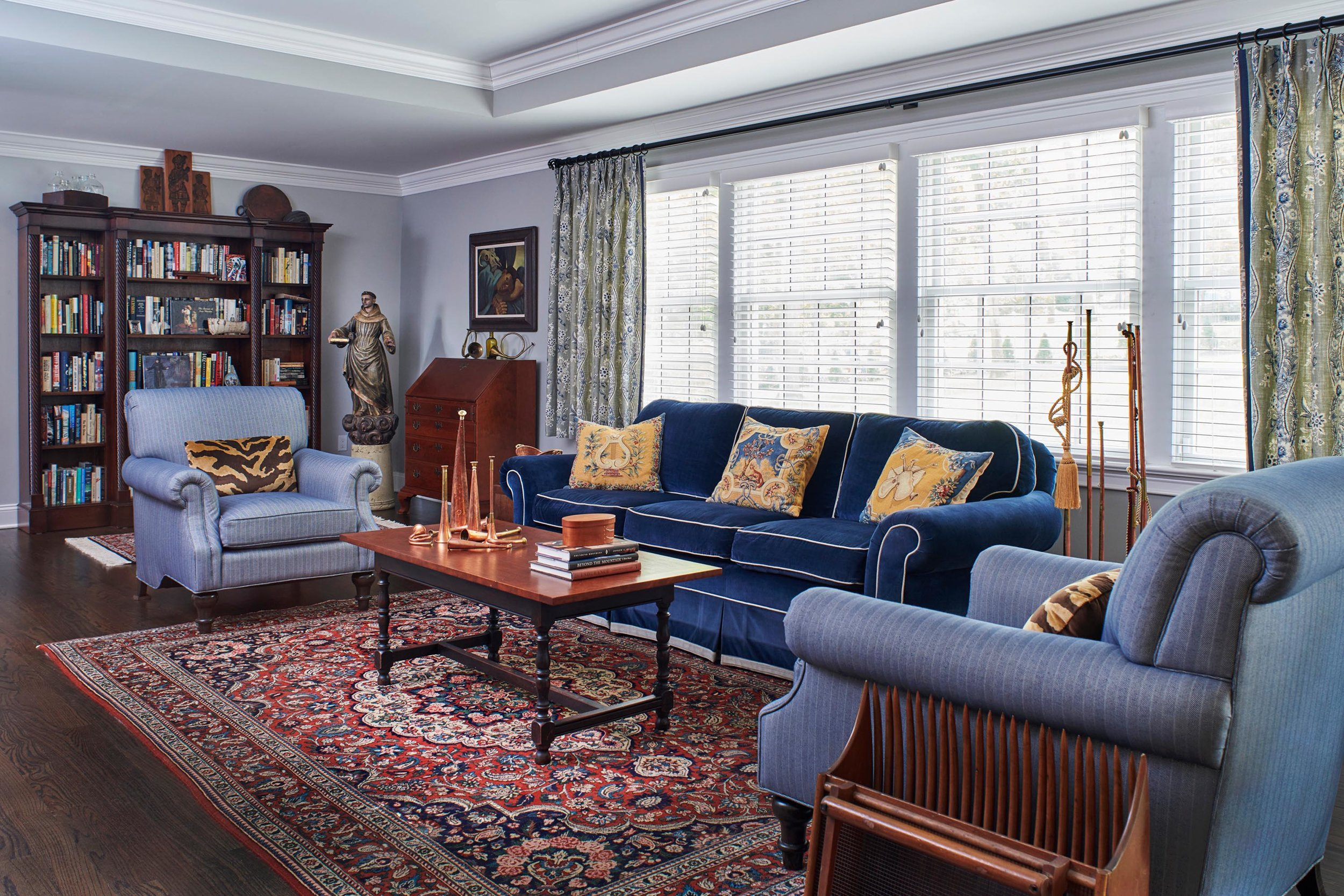 Traditional style living room with blue sofa and ornate rug