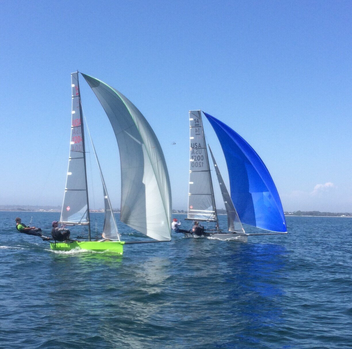 Brad Ruetenik/Garrett Brown(gray boat) trainining with Ted Conrads/Brian Haines(green boat).  Photo by Coach Glaser
