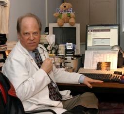 John at his desk - Image courtesy of Cari Brackett