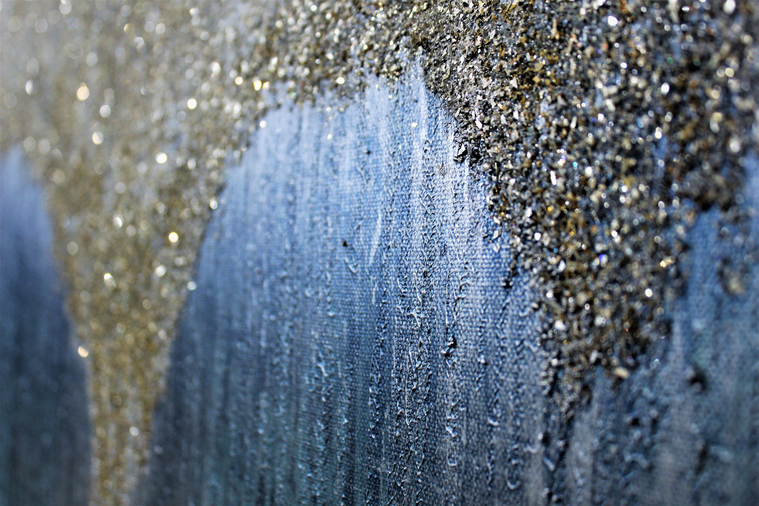 Detail shot of the stunning bits of texture and glam. This painting is a muted metallic silver and pale aqua with amazing bits of glass and glitter. $350 for this handmade 30 x 40 canvas by Painted Accent.