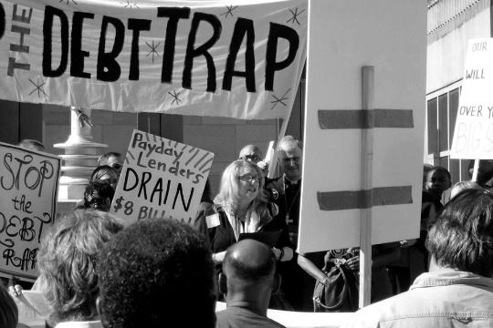 Protesters fighting against  unfair housing debt .