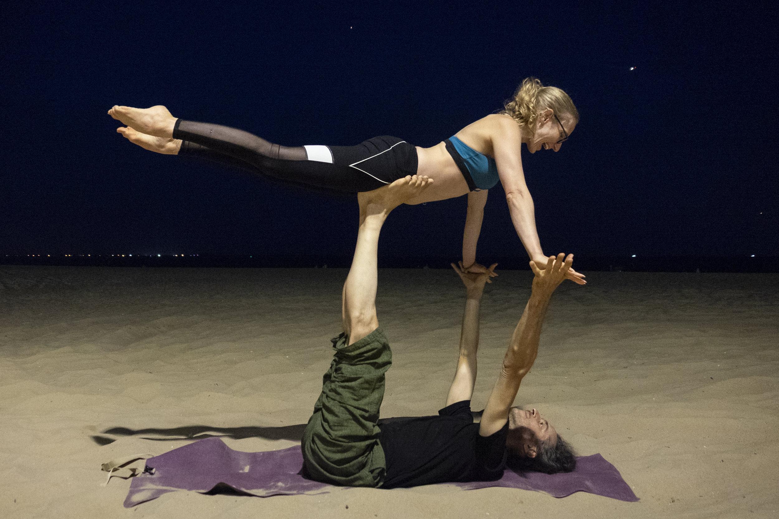 Testing out some acro yoga at Brighton Beach on my Yogo!