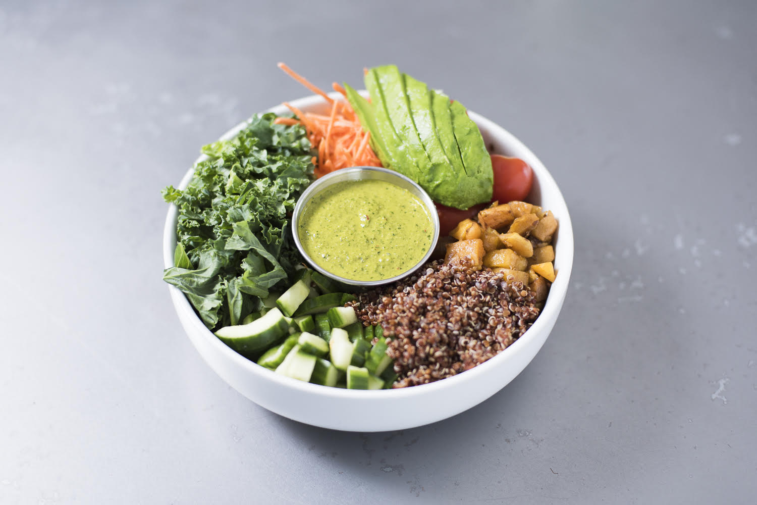 Quinoa Bowl with avocado, kale, roasted squash, cherry tomatoes, carrots, cucumbers Photo credit:  Blank Slate Coffee and Kitchen