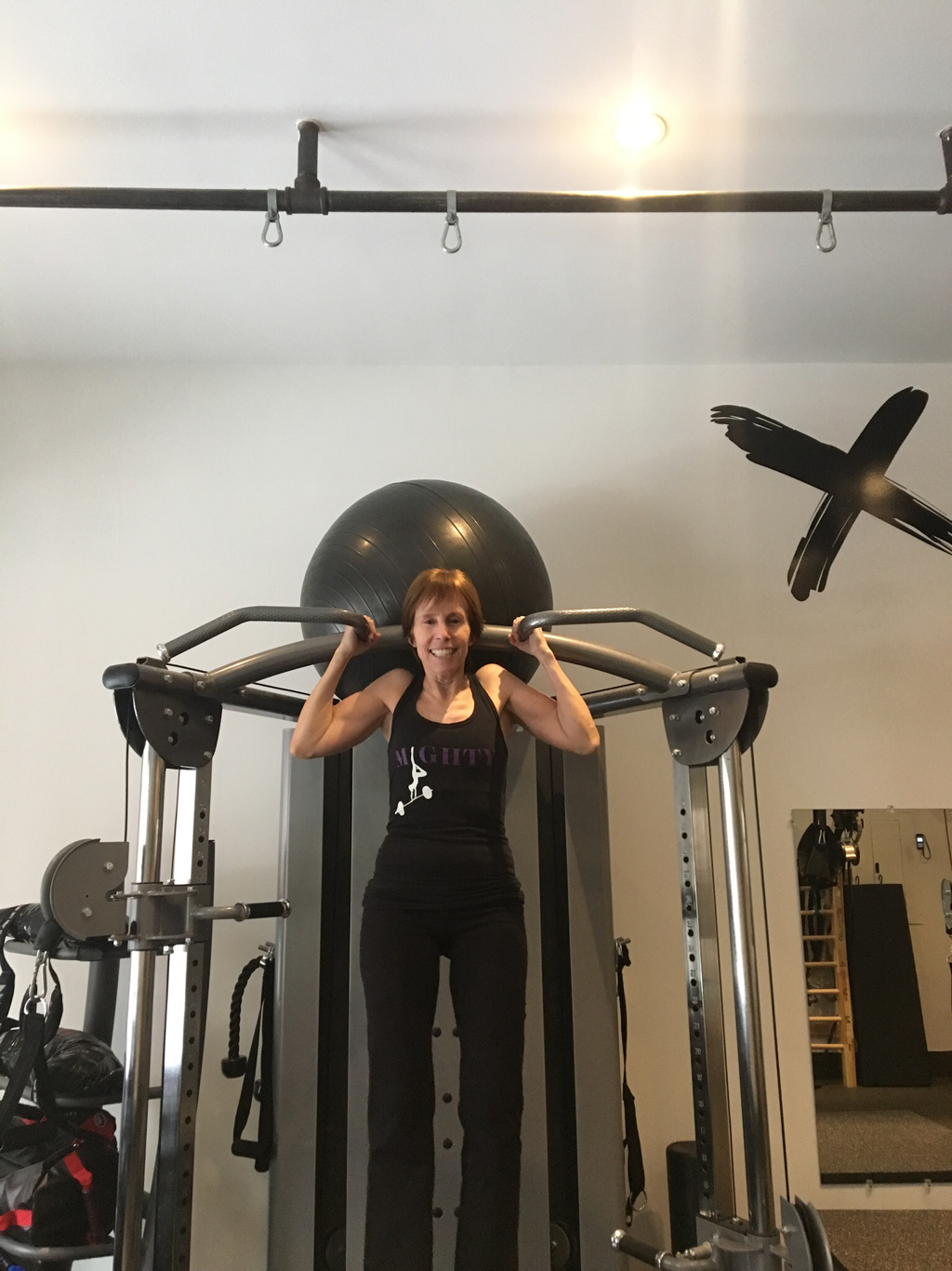 Roberta showing off her first pullup at age 62!