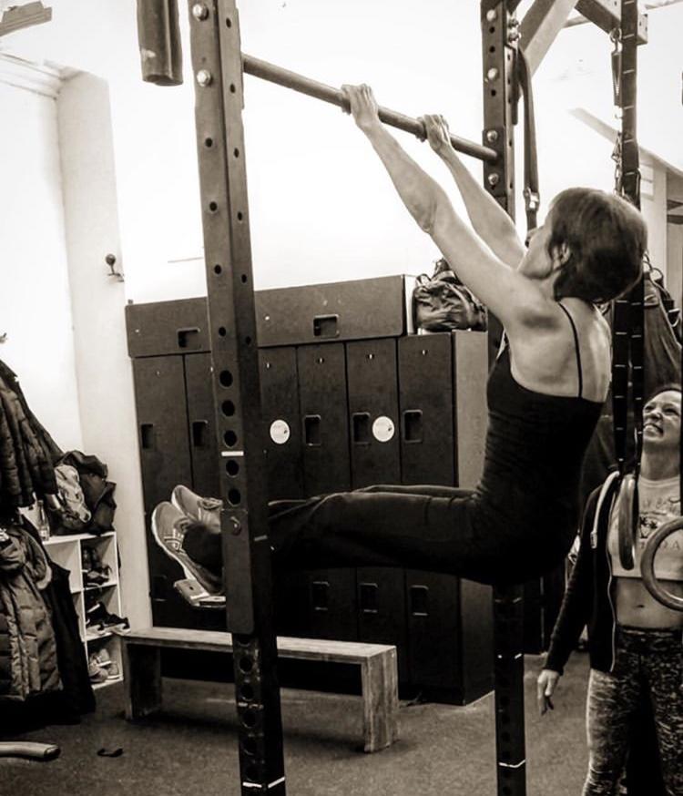 "Roberta working on a new gymnastics skill called ""kipping."""