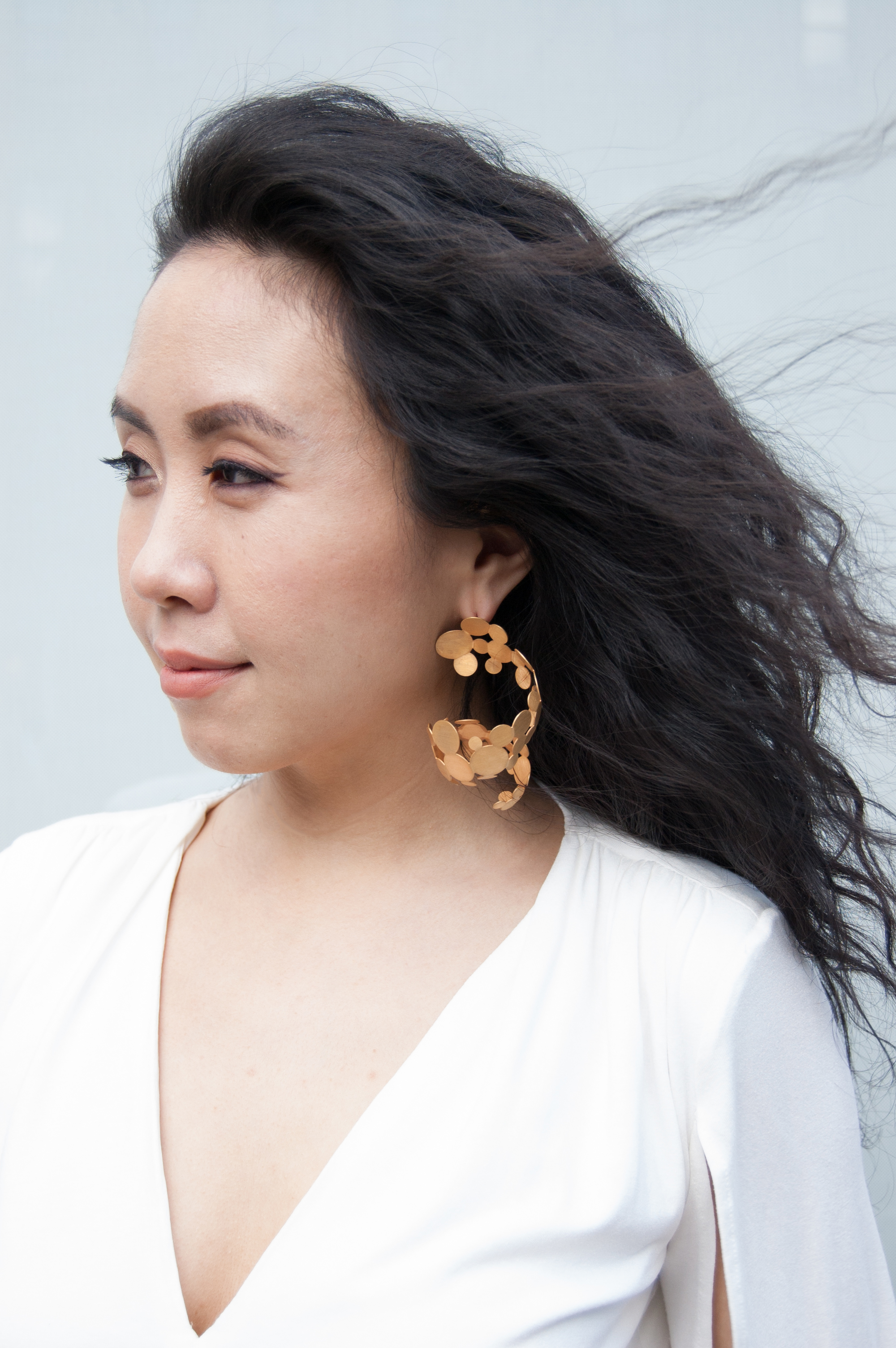 Designer Youngeun Han in her Cascading Gold earrings. Photo by: Jeemin Kim.