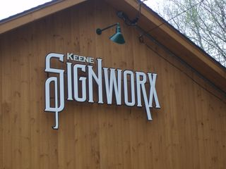 New Signworx sign on the side of the new shop