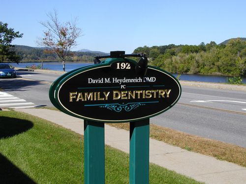 David Heydenreich DMV Family Dentistry. A carved sign with lights