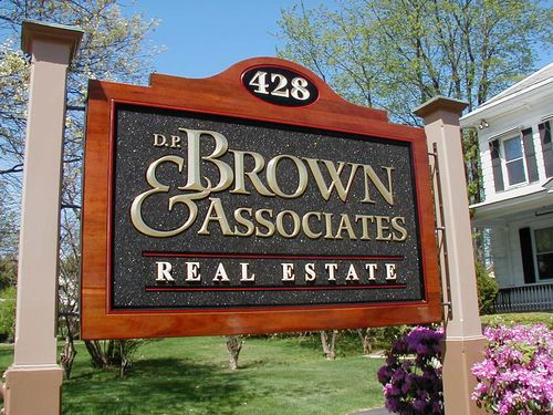 Brown & Associates Real Estate sign, carved from mahogany