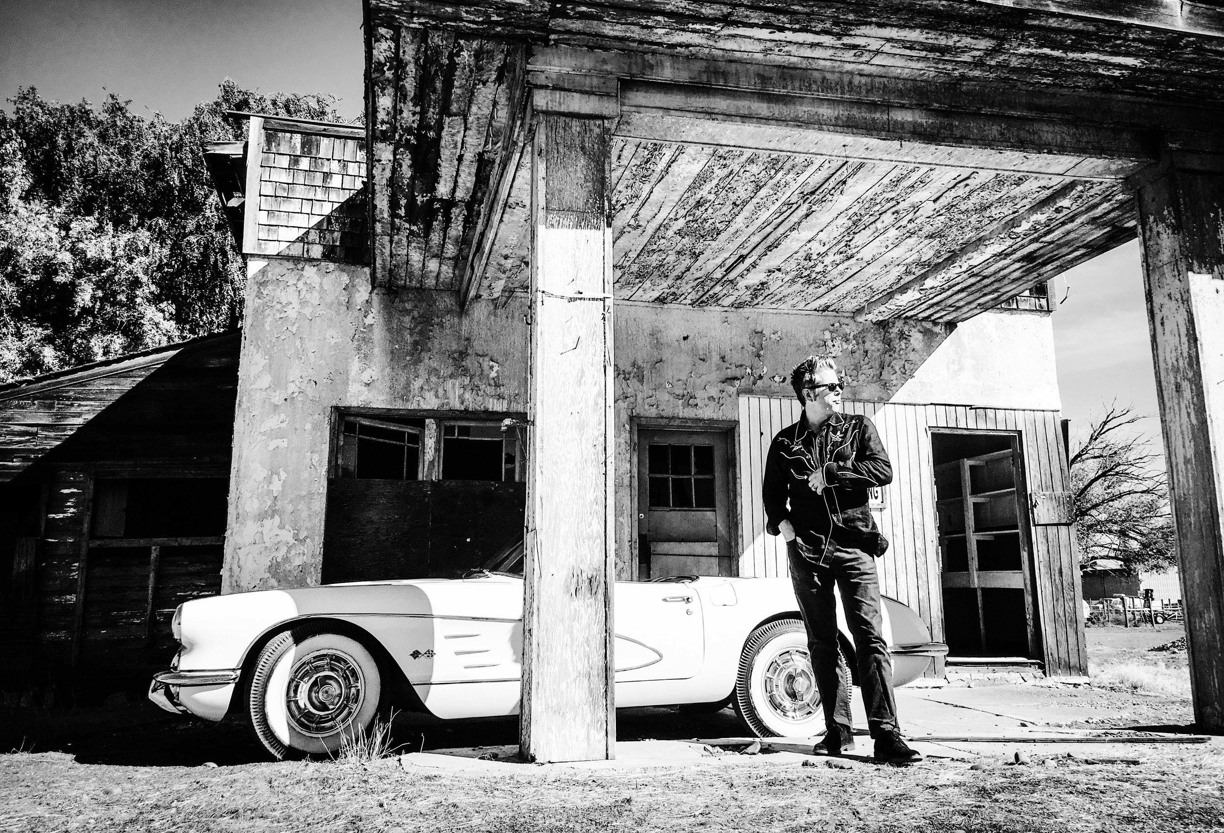 Mark Pickerel and Corvette outside Ellensburg.jpg