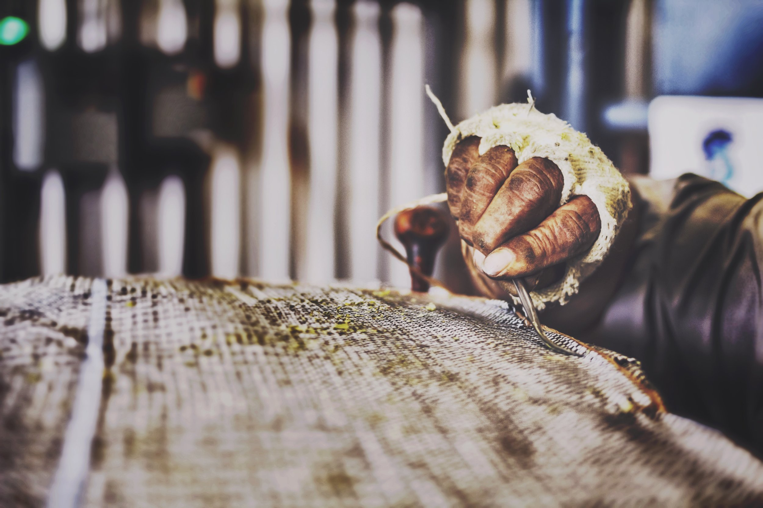 Hand Sewing Hop Bale.JPG