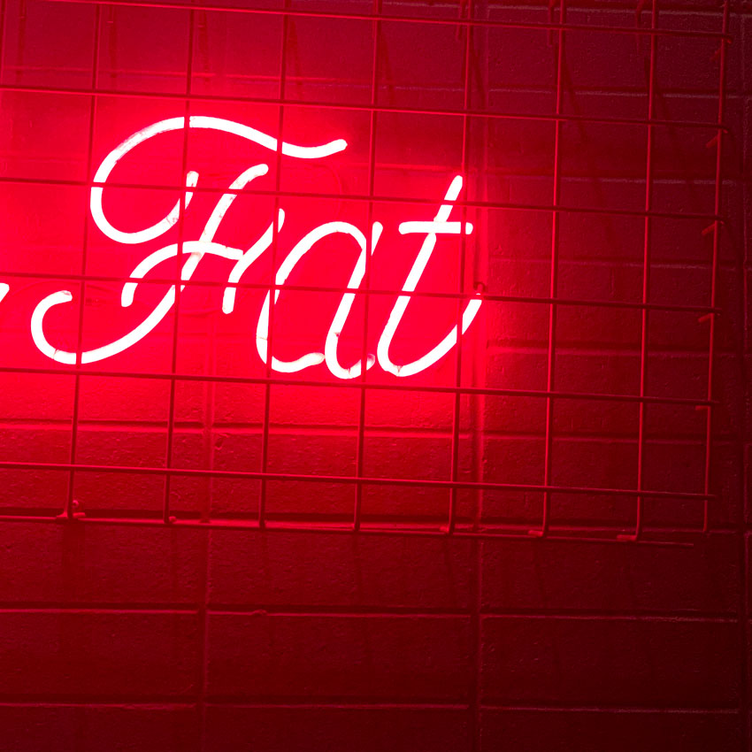 "A Portion Of A Sign For ""Le Fat"""