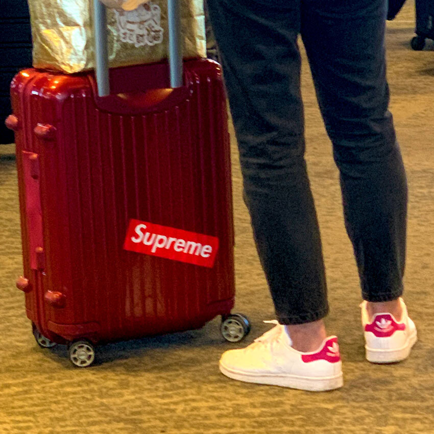 Branded Red Airport Fashions