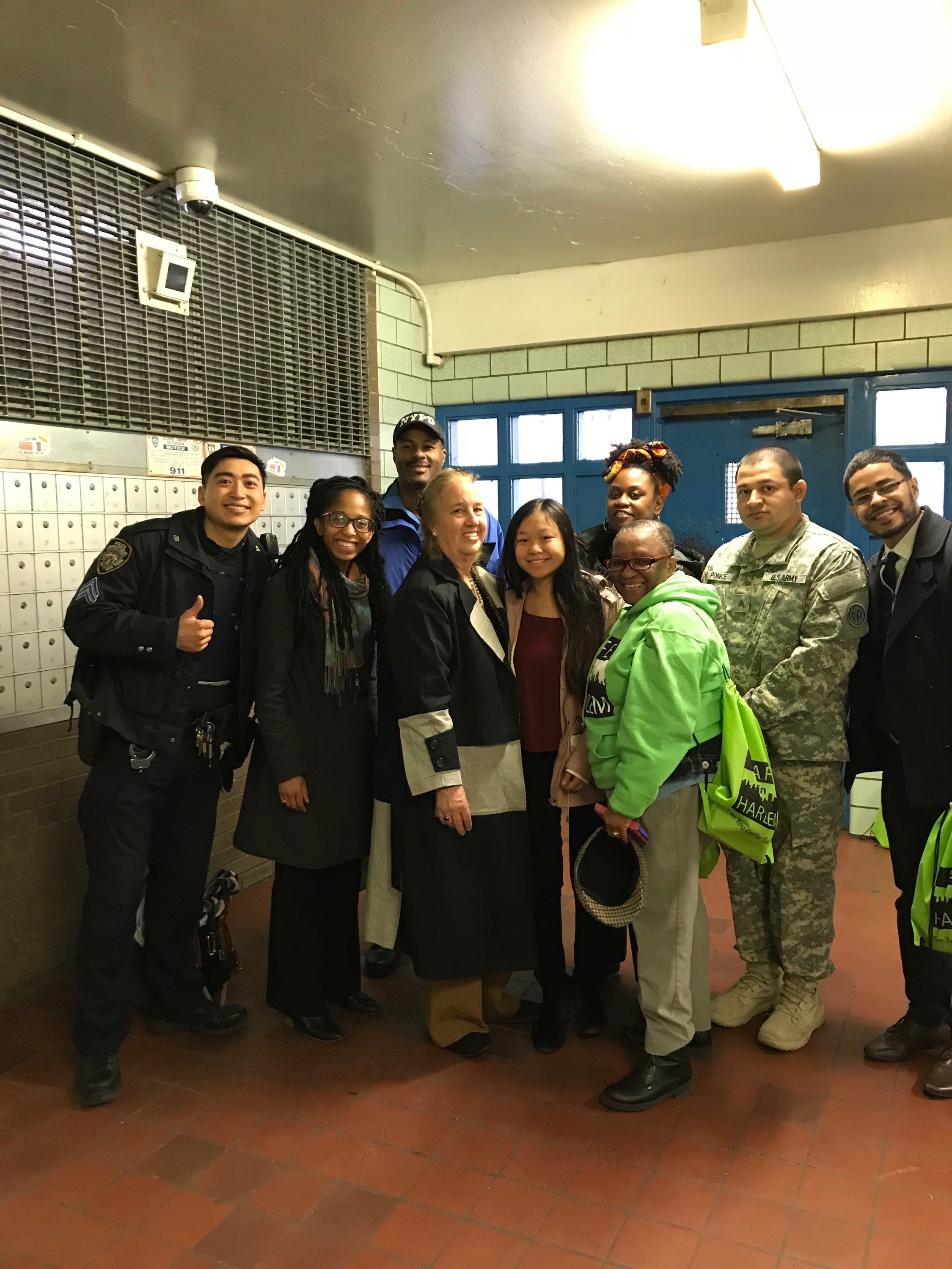 Manhattan Borough President, Gale Brewer, with partners disseminating information at the Ulysses S. Grant Houses.