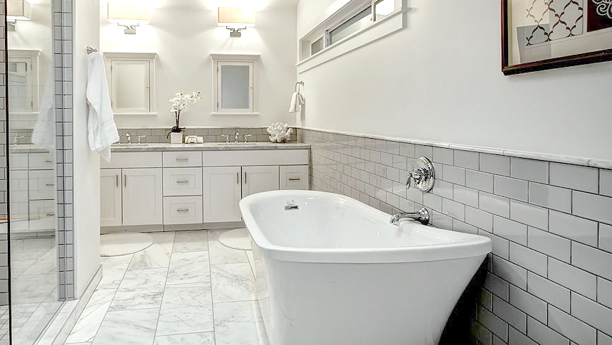 Bathroom white subway tile Marbl tile floor marble counter top standing tub walk in shower ideas inspiration.jpg