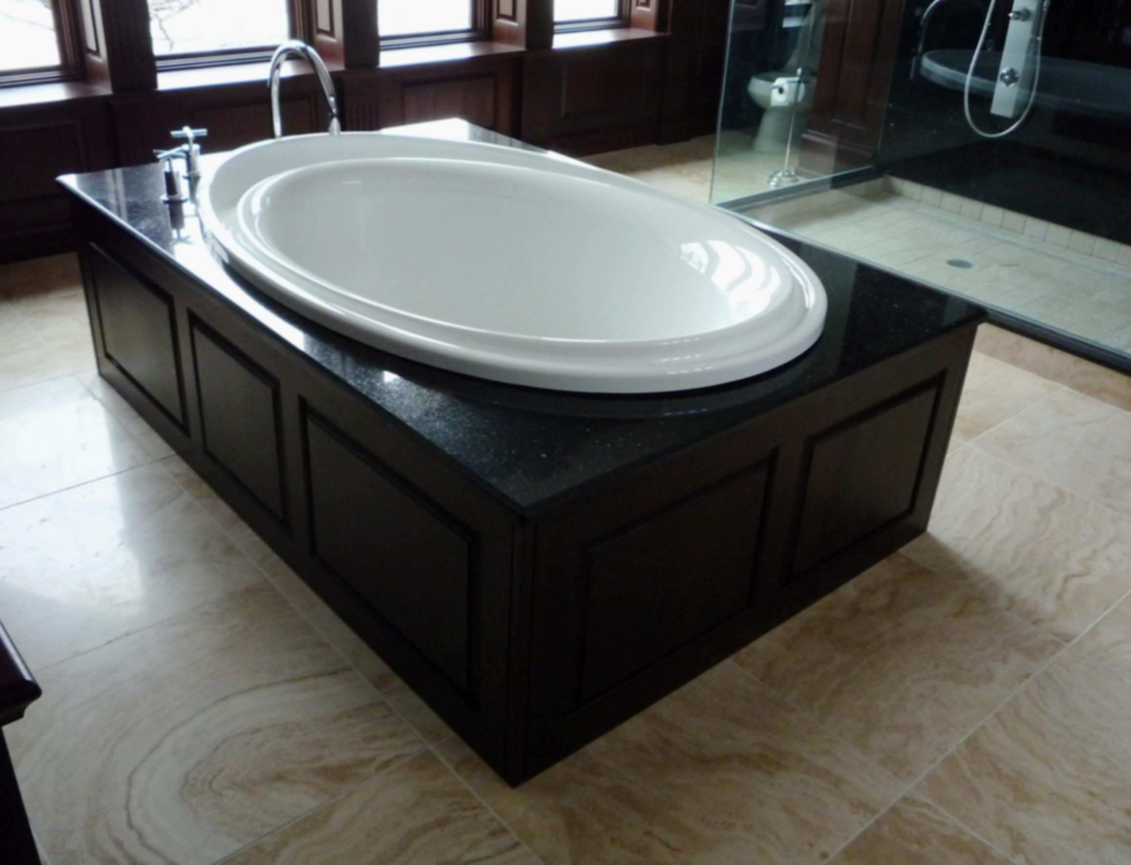 Bathroom marble tile floor standing tub.jpg