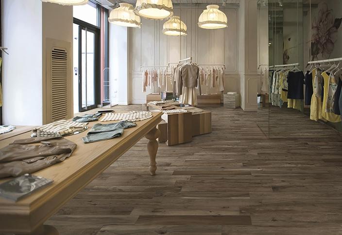 Office retail showroom fashion clothing store wood look tile hardwood floor ideas inspiration.jpg