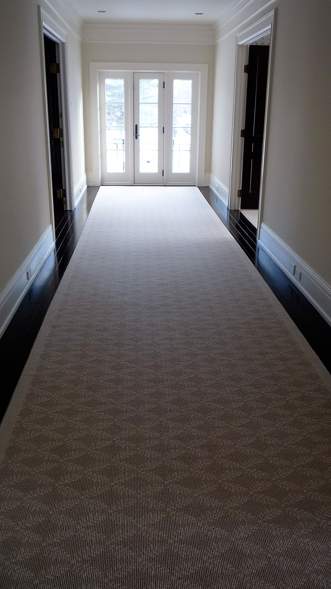 Living area hallway hardwood floors carpet runner.jpg
