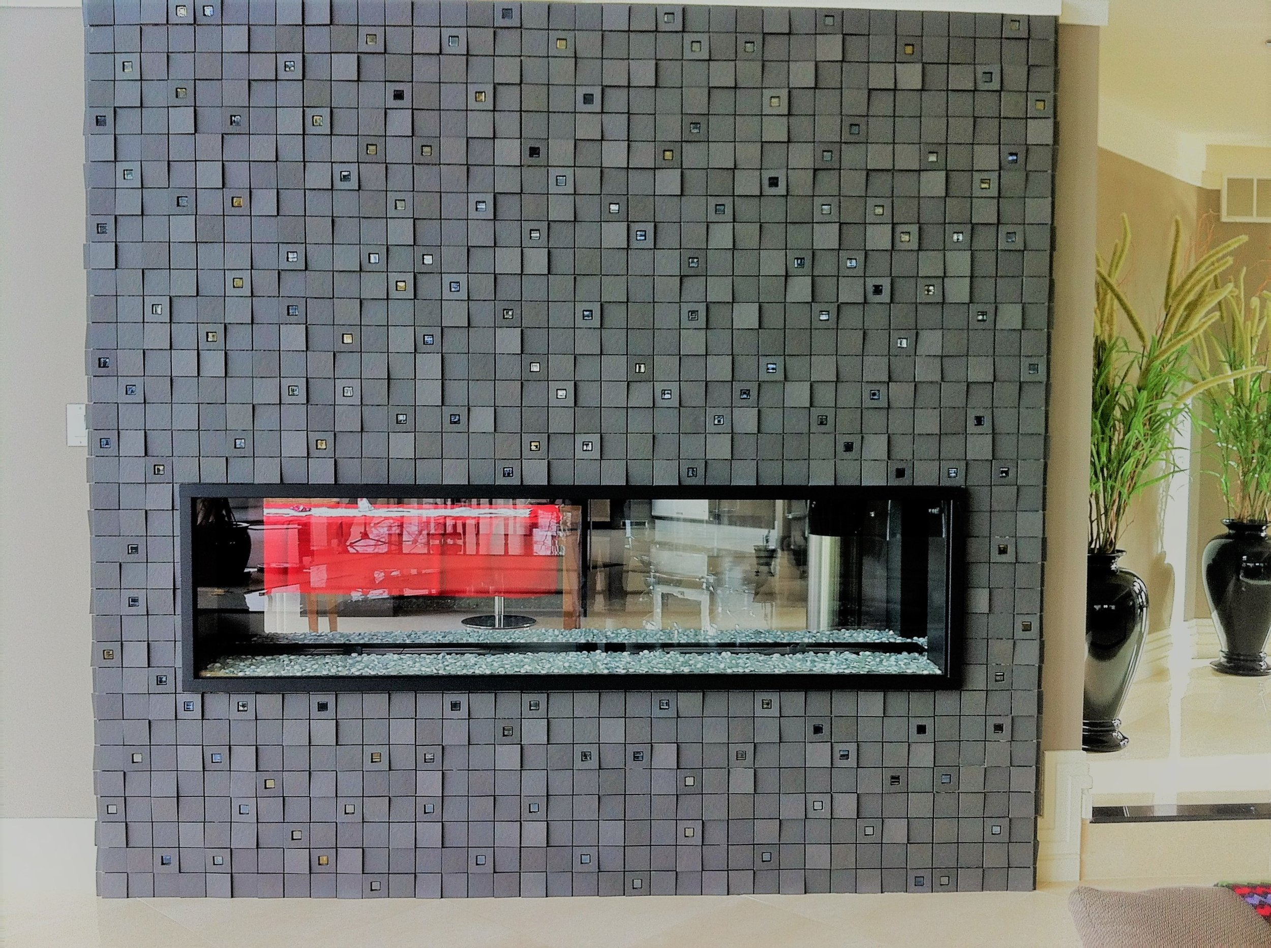 Living area fireplace surround glass stone.JPG