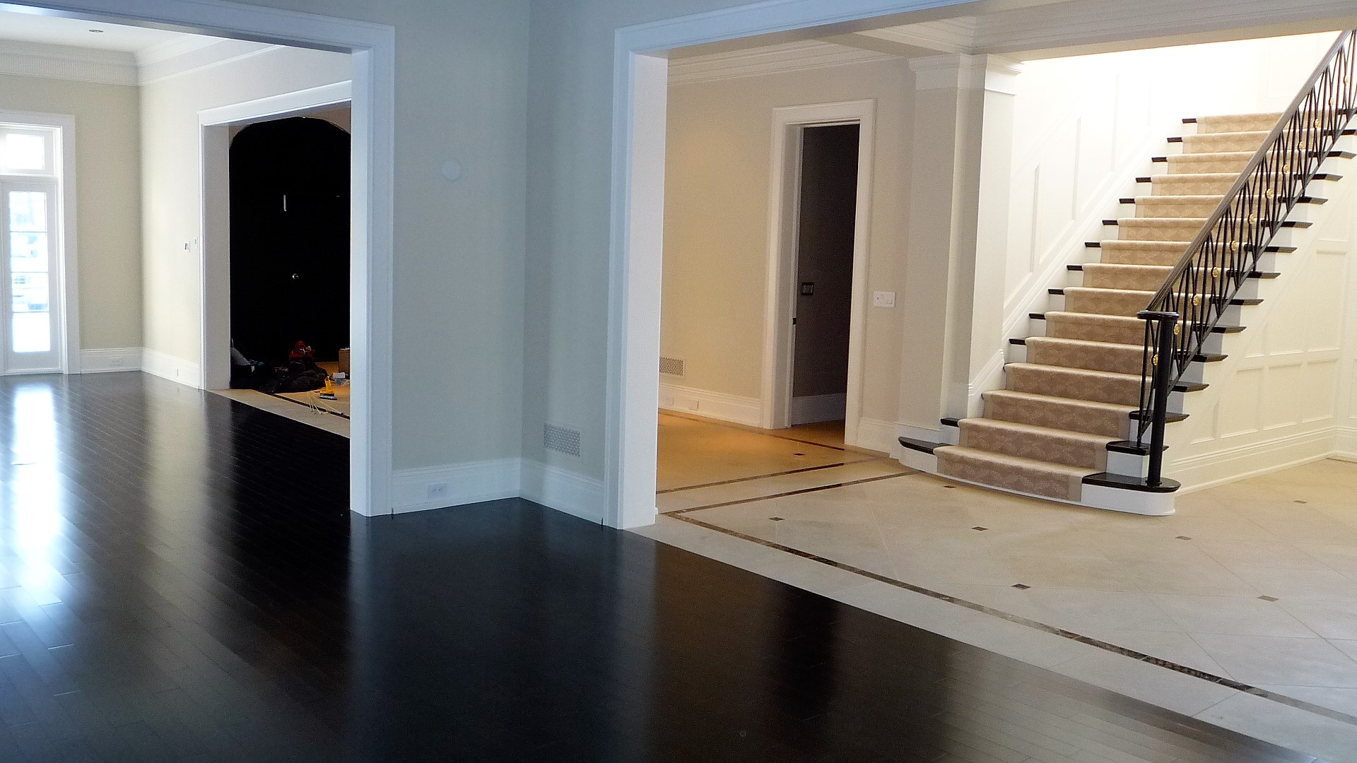 Living area Hardwood floors dark large stone tiles hardwoodstairs carpet runner.jpg