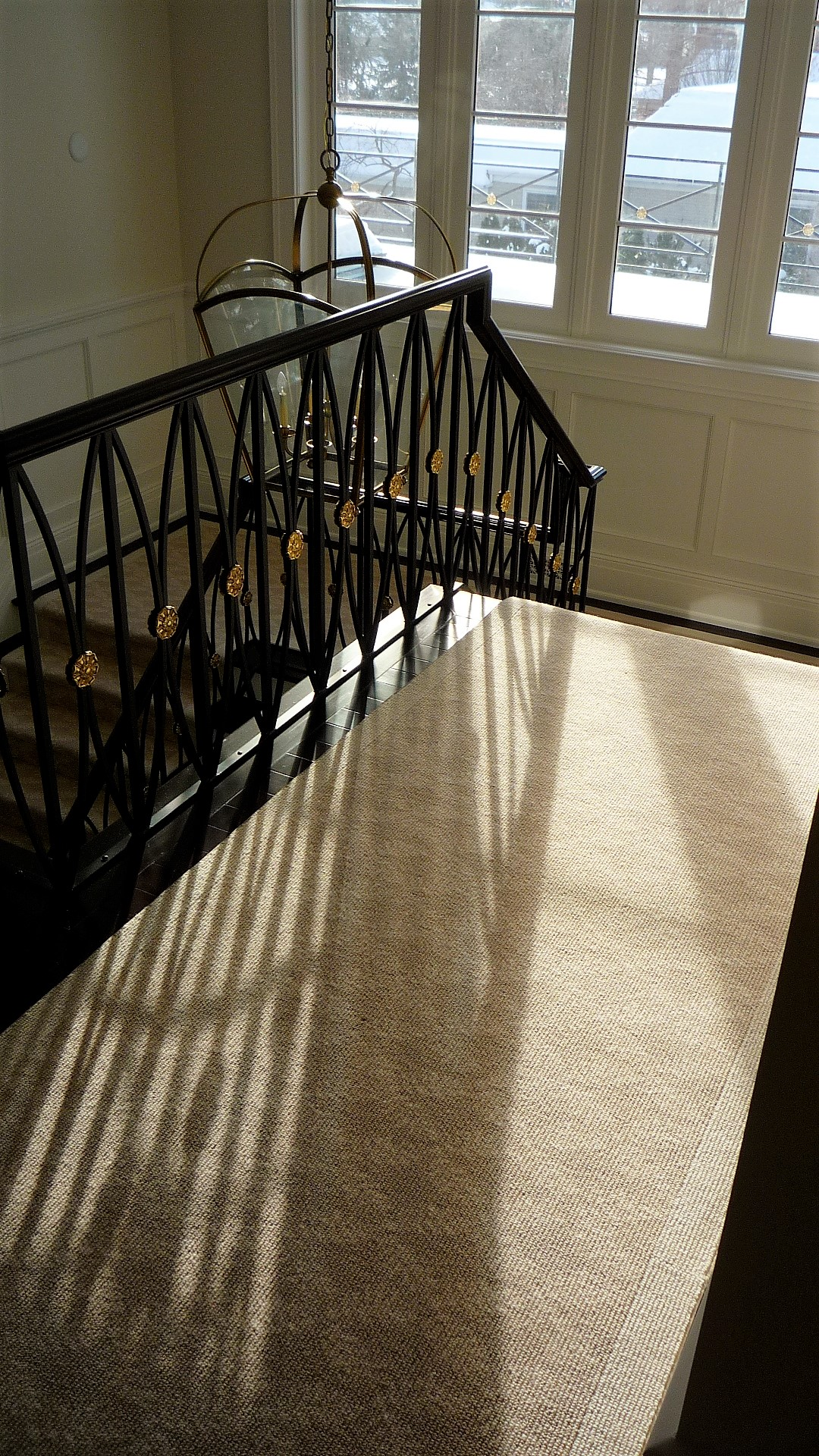Living area hardwood stairs carpet runner white.jpg