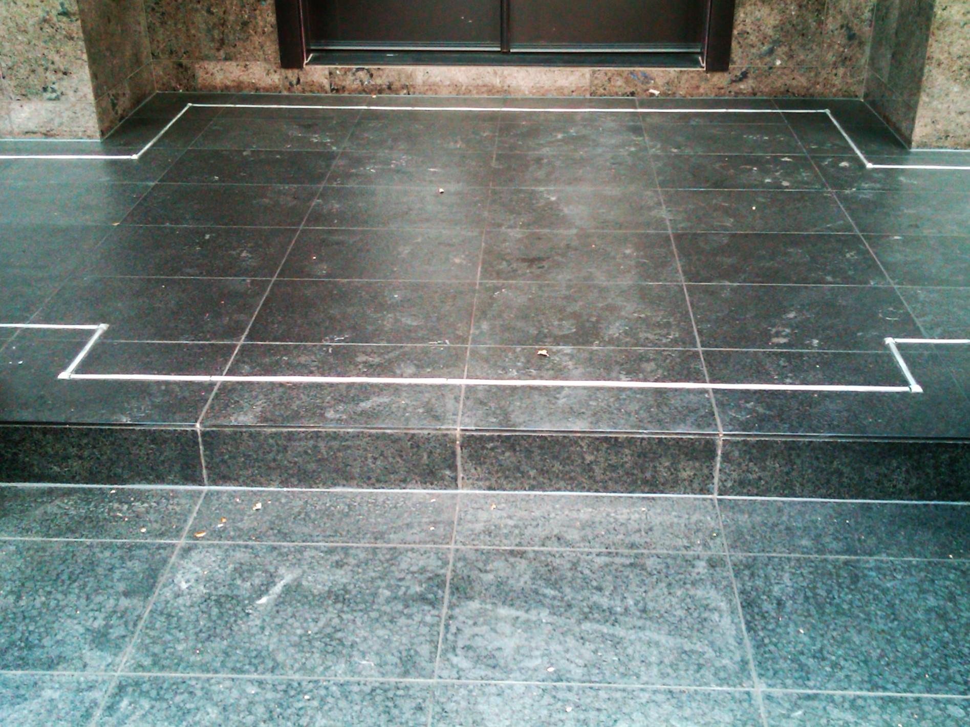 Outdoor patio stone tile front door.jpg