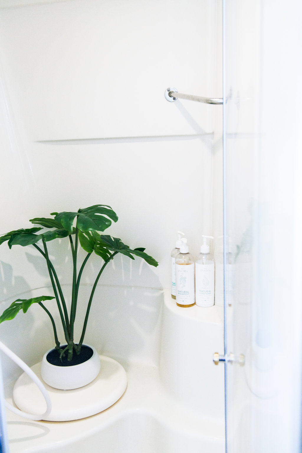 Our shower is surprisingly roomy. But you can't get too comfortable in there - the water heater only heats up about 15 minutes' worth of hot water at a time.
