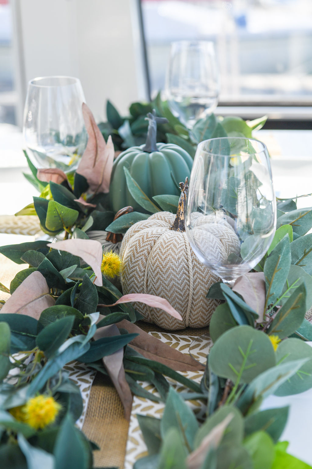I also grabbed a couple of faux garlands to lay across the table. And that runner is simple burlap.