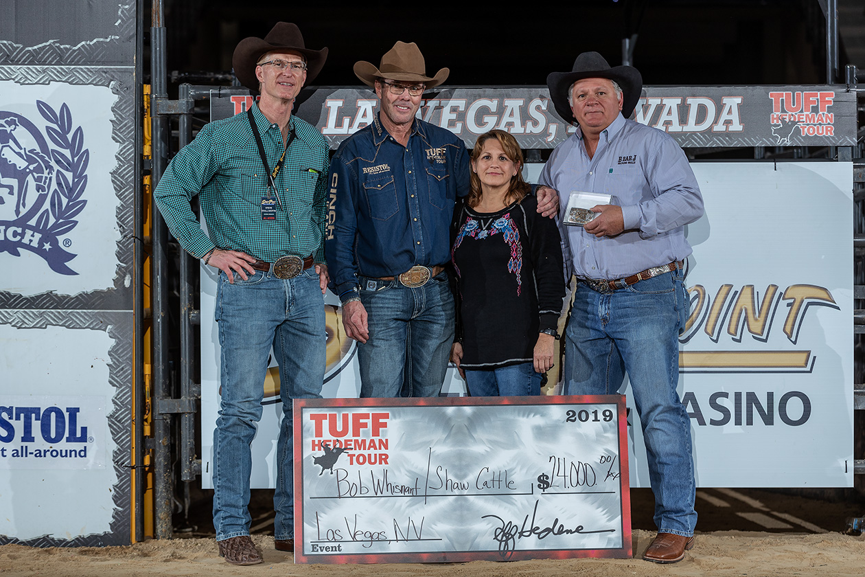 Steve Stallworth of the South Point and Tuff Hedeman present Bob and Julie Whisnant and Hayden Shaw Cattle Co. with the Las Vegas Bull Team Championship.