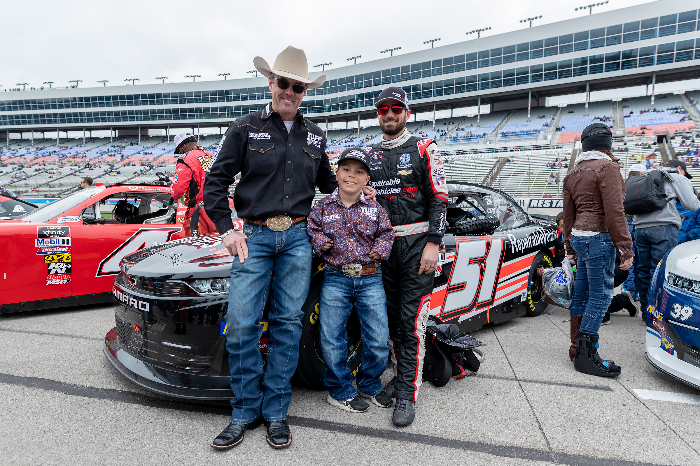 Tuff Hedeman and Caleb with NASCAR Xfininty driver Jeremy Clements, @JCR Racing at the spring race at Texas Motor Speedway.