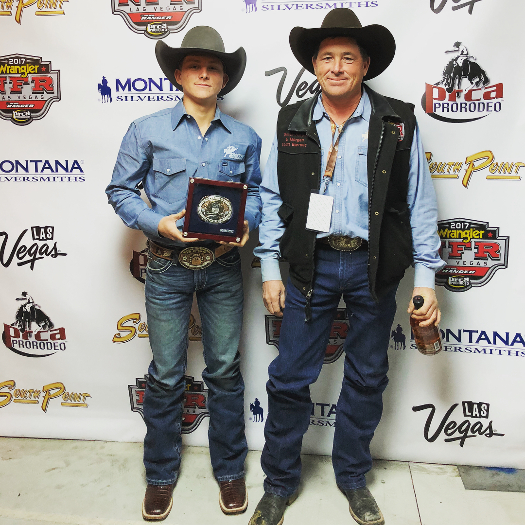 Garrett and Scott Burruss, Bradford, Arkansas accepting round win buckles for the bucking stock at the National Finals Rodeo in Las Vegas.
