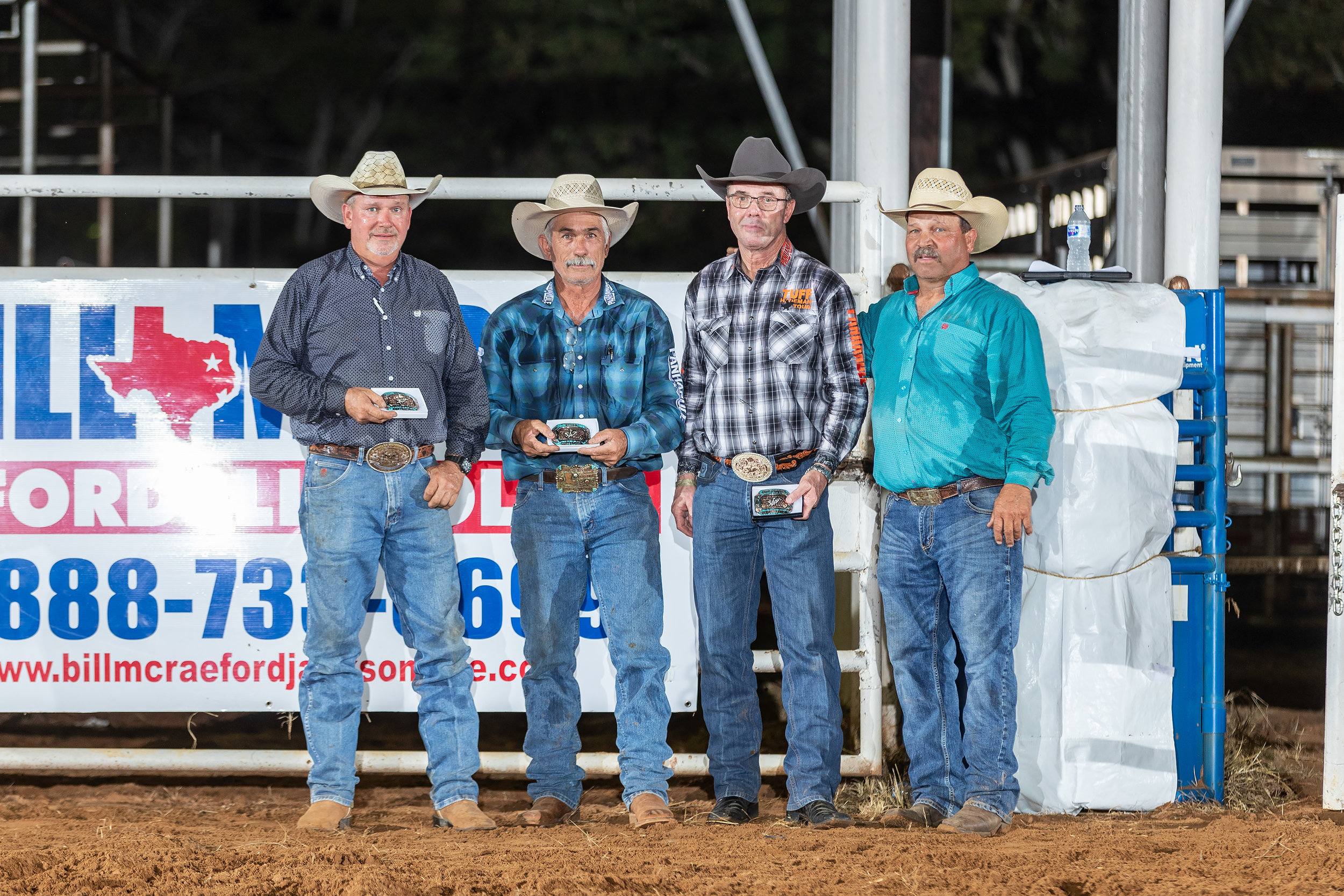 Jeff Harris presents trophy buckles to Tuff Hedeman and stock Contractors Lyndal Hurst, and Mike Rawson thanking them for their time and efforts in supporting the event that serves as the primary fundraiser for the Cherokee County 4-H and FFA Scholarship programs.