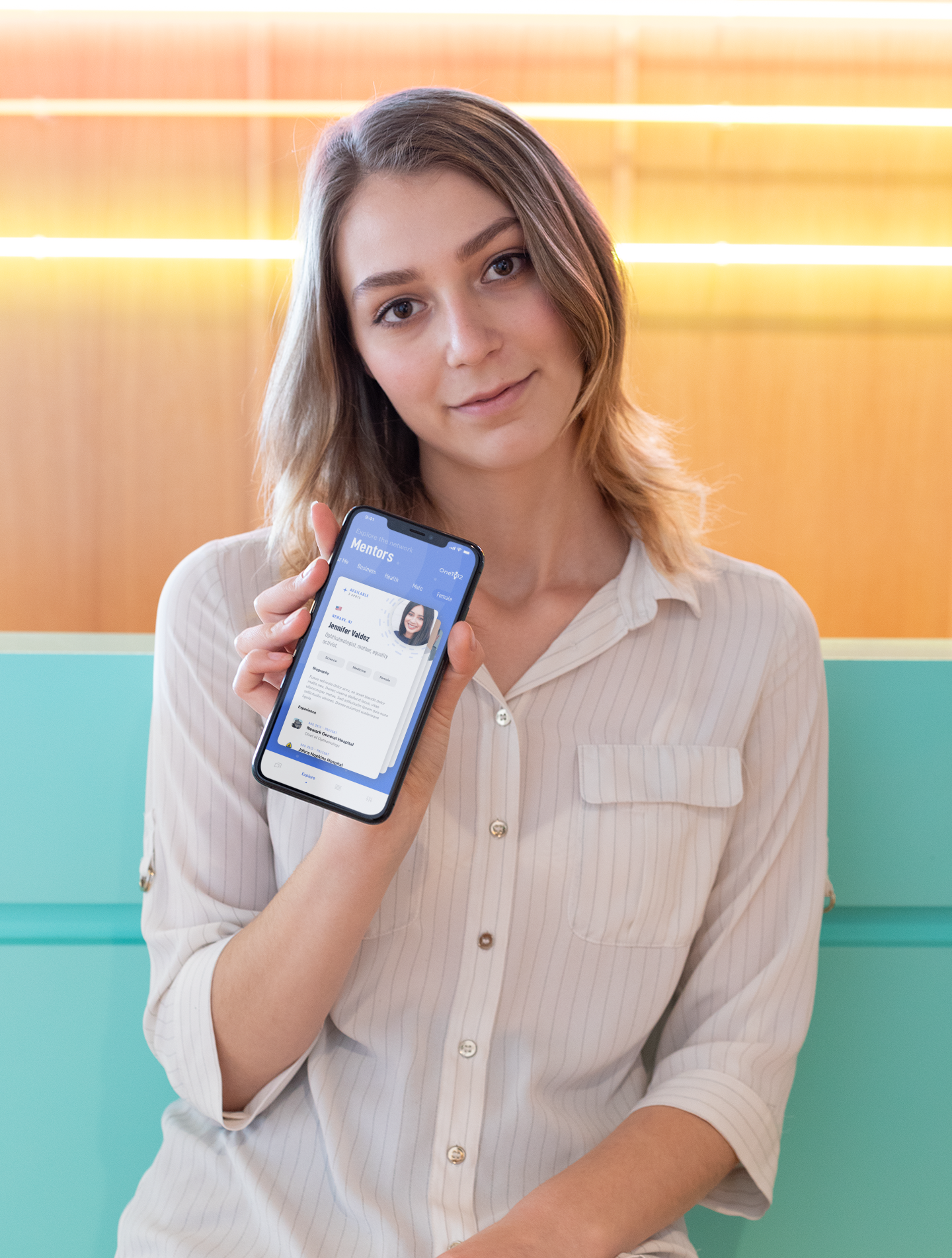 mockup-of-a-cute-girl-holding-her-iphone-xs-max-in-a-cool-illuminated-room-25433.png