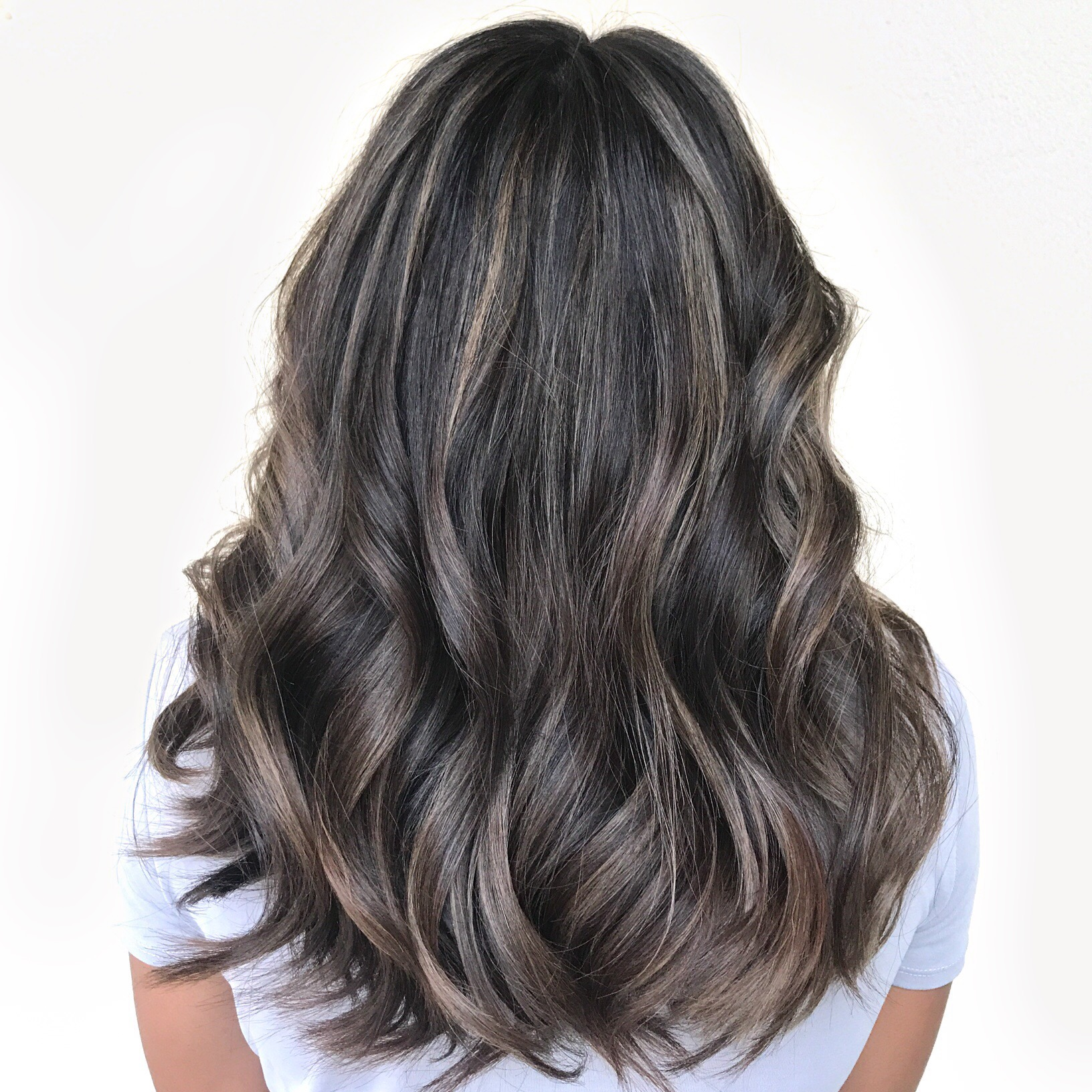 Cool blonde on dark hair, long layers