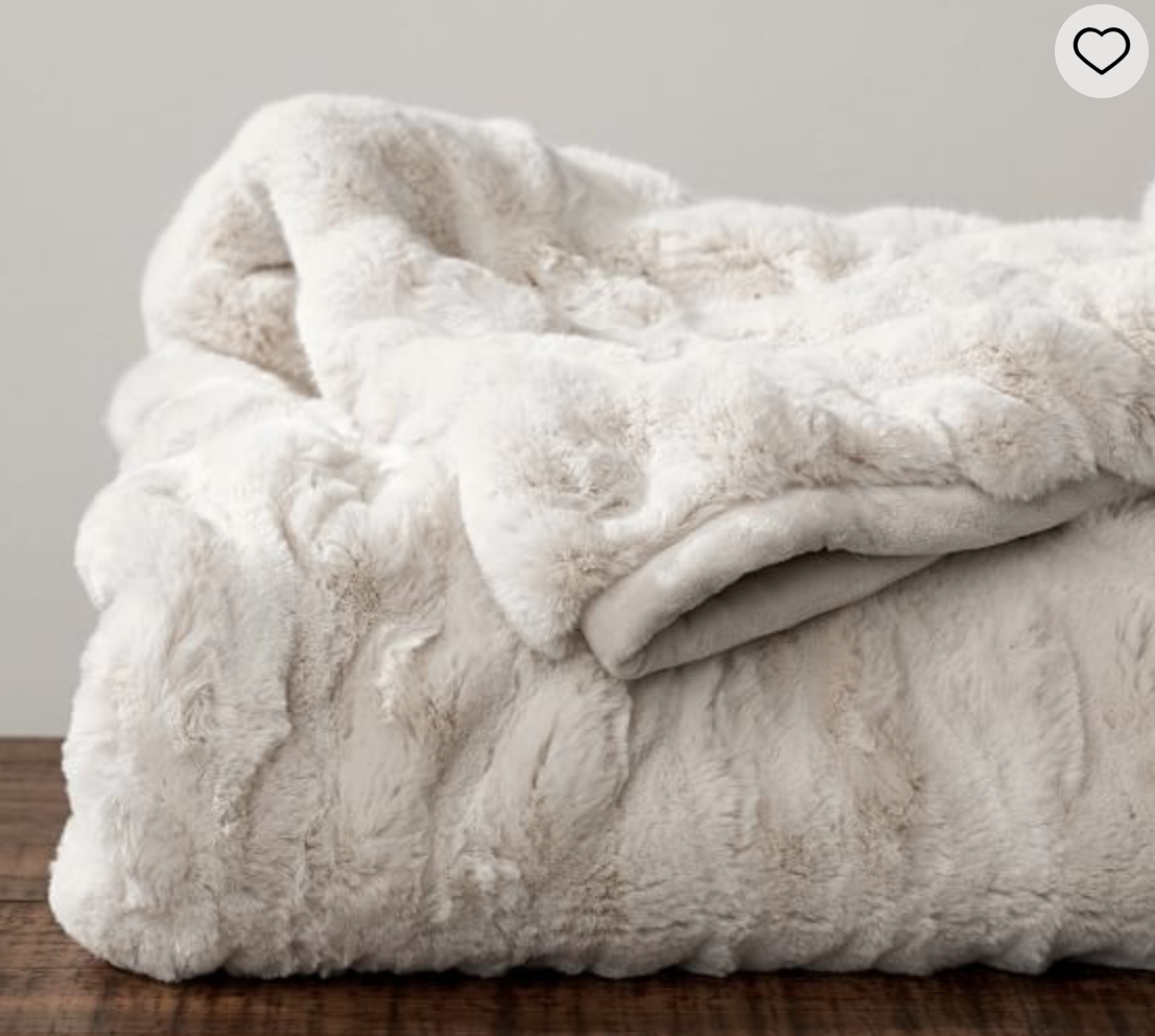"""Pottery Barn Faux Fur Throw    This gift is a little pricey and indulgent, but oh my goodness is it one of the best inventions this world has ever seen. We got one for Christmas 3 years ago and it remains the best blanket I've ever had. We call it the """"bear blanket"""" and when you are using it you feel like you're wrapped in the softest coziest bear hug. I can honestly say this has ridden out many a migraine with me and one of my favorite items."""