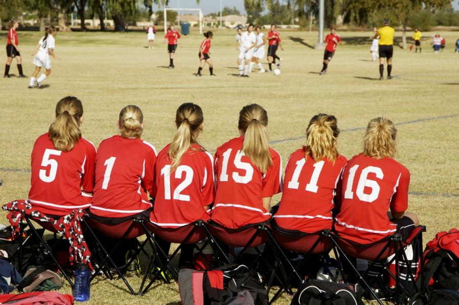 soccer-girls-sitting-on-bench-081616.jpg
