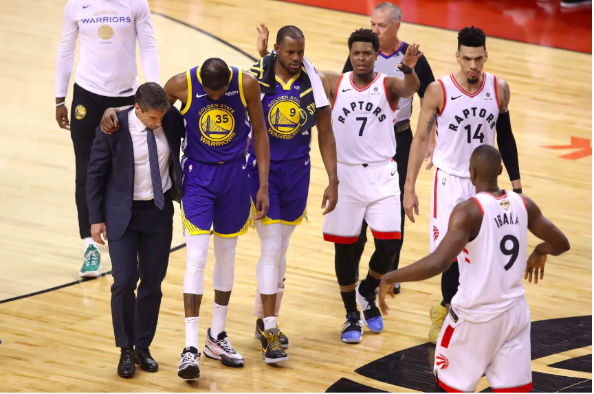 Kyle Lowry, Danny Green & Serge Ibaka assisting Durant after his injury.