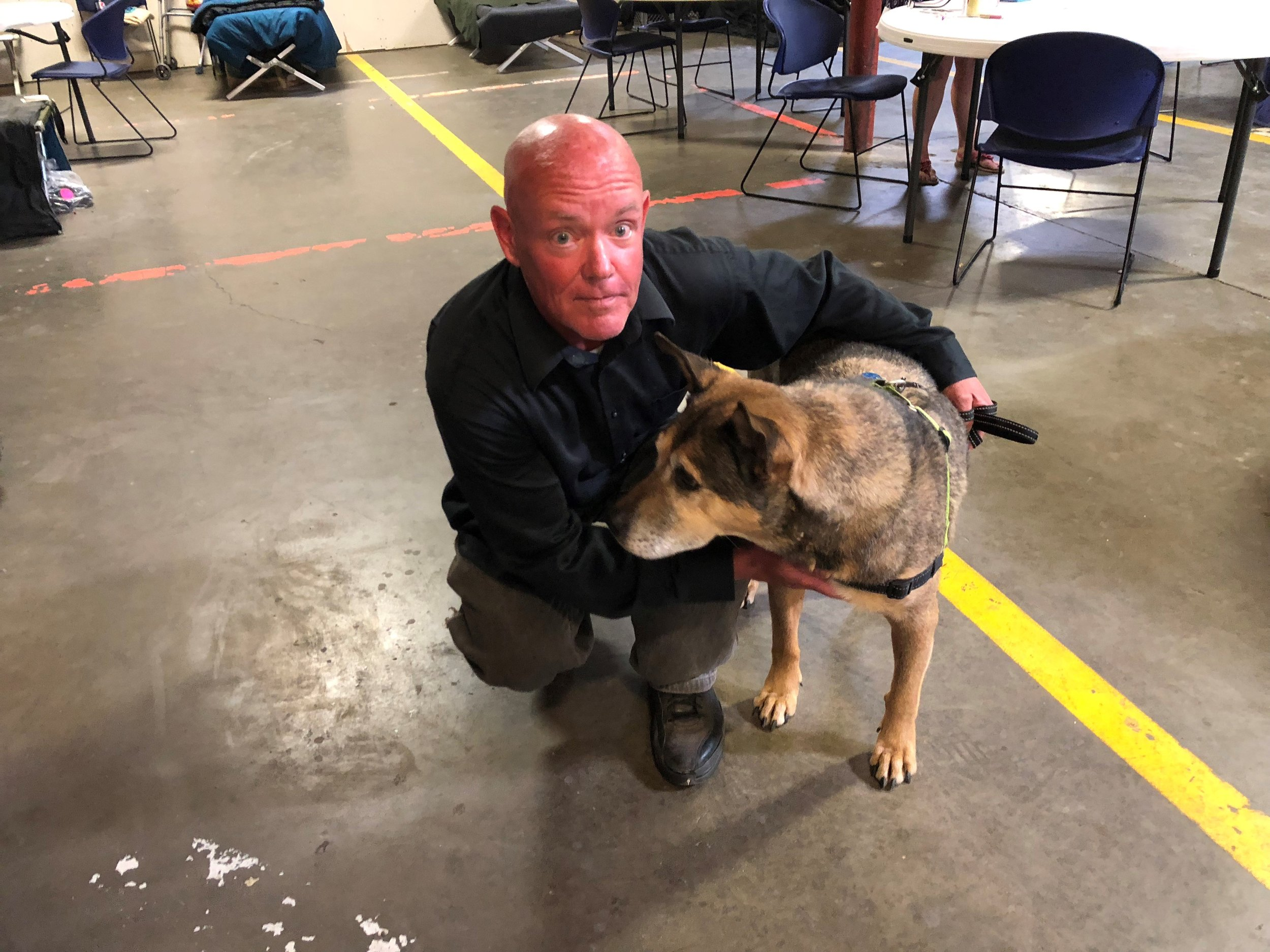 """James Fitzhugh has been homeless for three years and has spent most of his time on the street. Here he is with his dog, Ruben Sierra. James is currently looking for a job. He says the Triage Center has """"saved a lot of people."""""""
