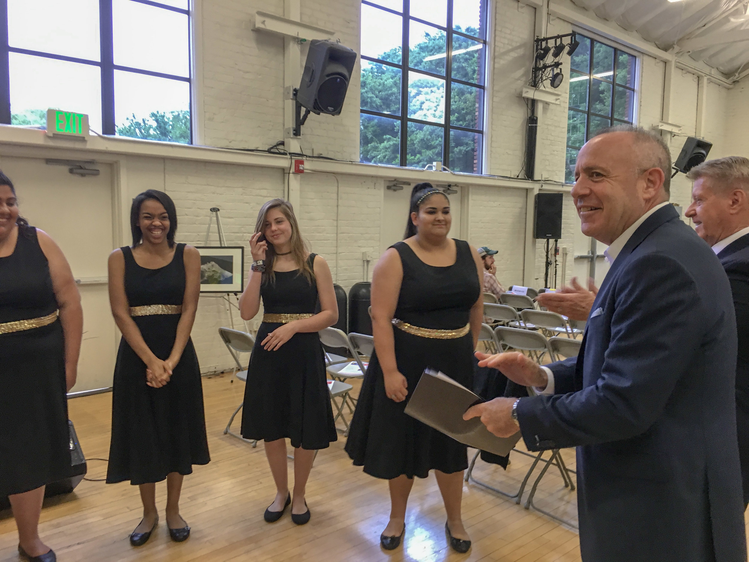 Mayor Darrell Steinberg applauds Rio Linda High School NYN (Not Yet Named) Choir at the CLARA auditorium