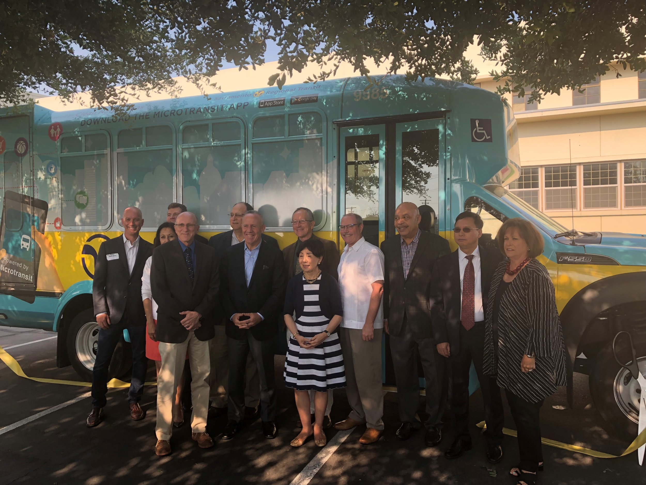 Mayor Darrell Steinberg joined other elected officials and SacRT staff in front of the new microshuttle.