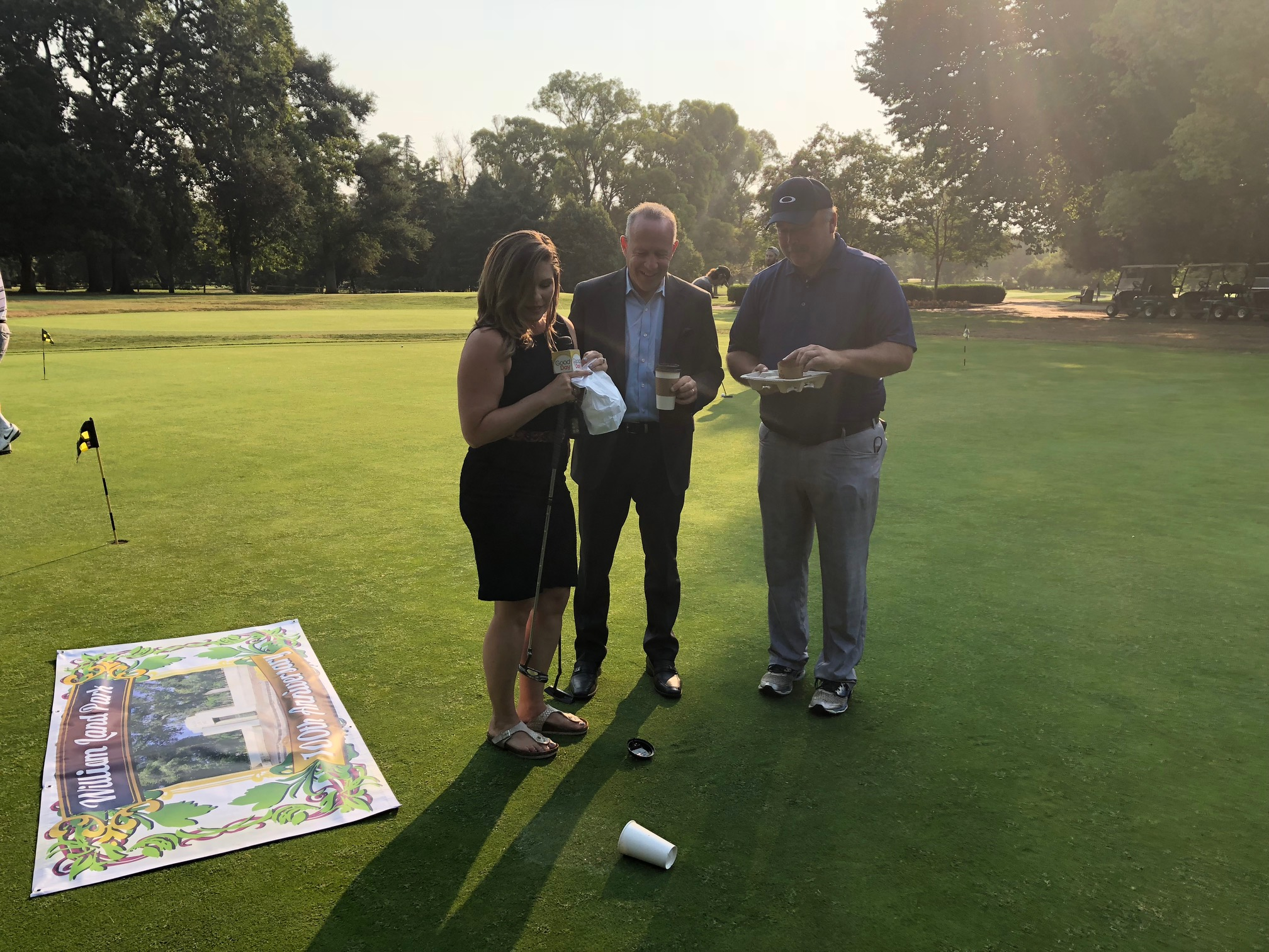 Things went awry when Bethany Crouch dropped her coffee on camera. But the group still got to have ice cream for breakfast. Vic's Ice Cream created the special flavor, mint chip cookie, just for the Land Park anniversary. To the right is golf course General Manager Hank Vereschzagin.