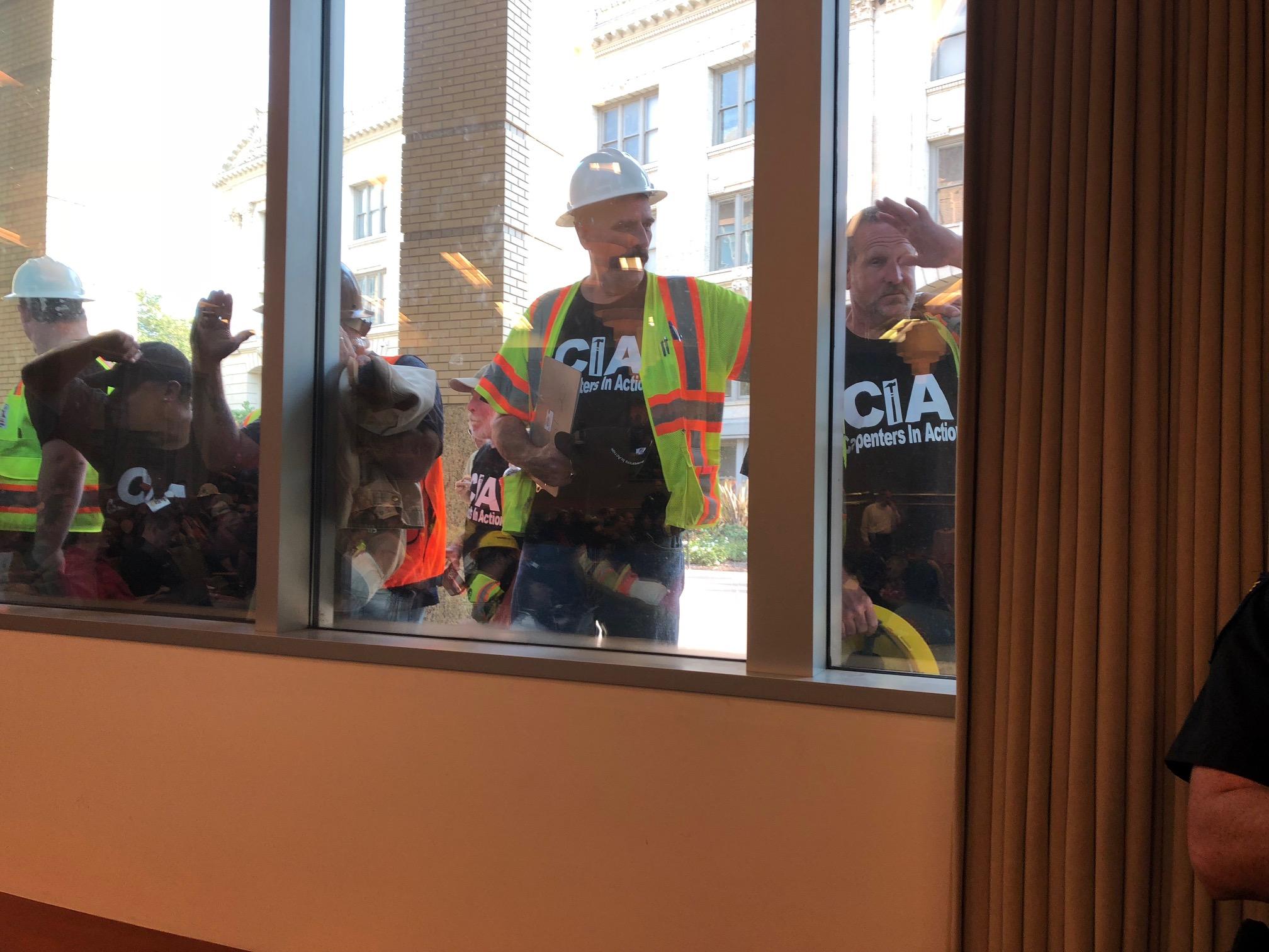 PLA workers outside.jpg
