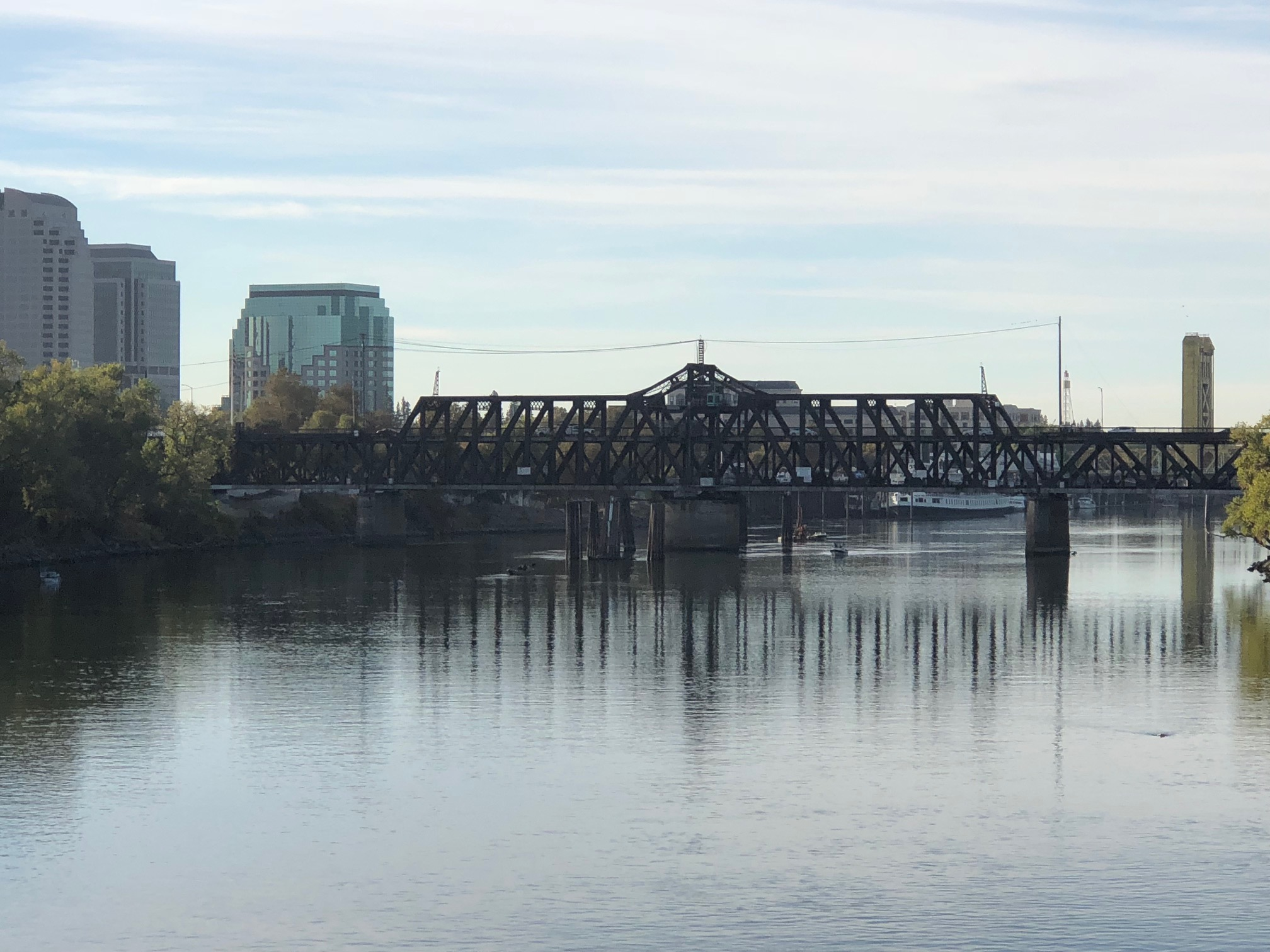 View of the I Street and Tower bridges between Sacramento and West Sacramento on a clear day.