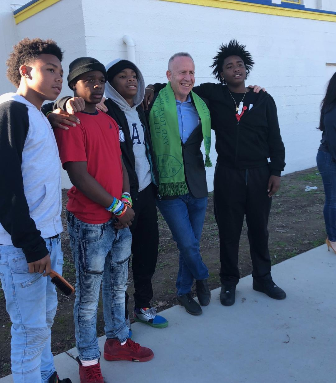 Mayor Steinberg and young men from the Brother to Brother organization after the January announcement at Grant High School that Comcast would donate $300,000 to help fund events for teens.