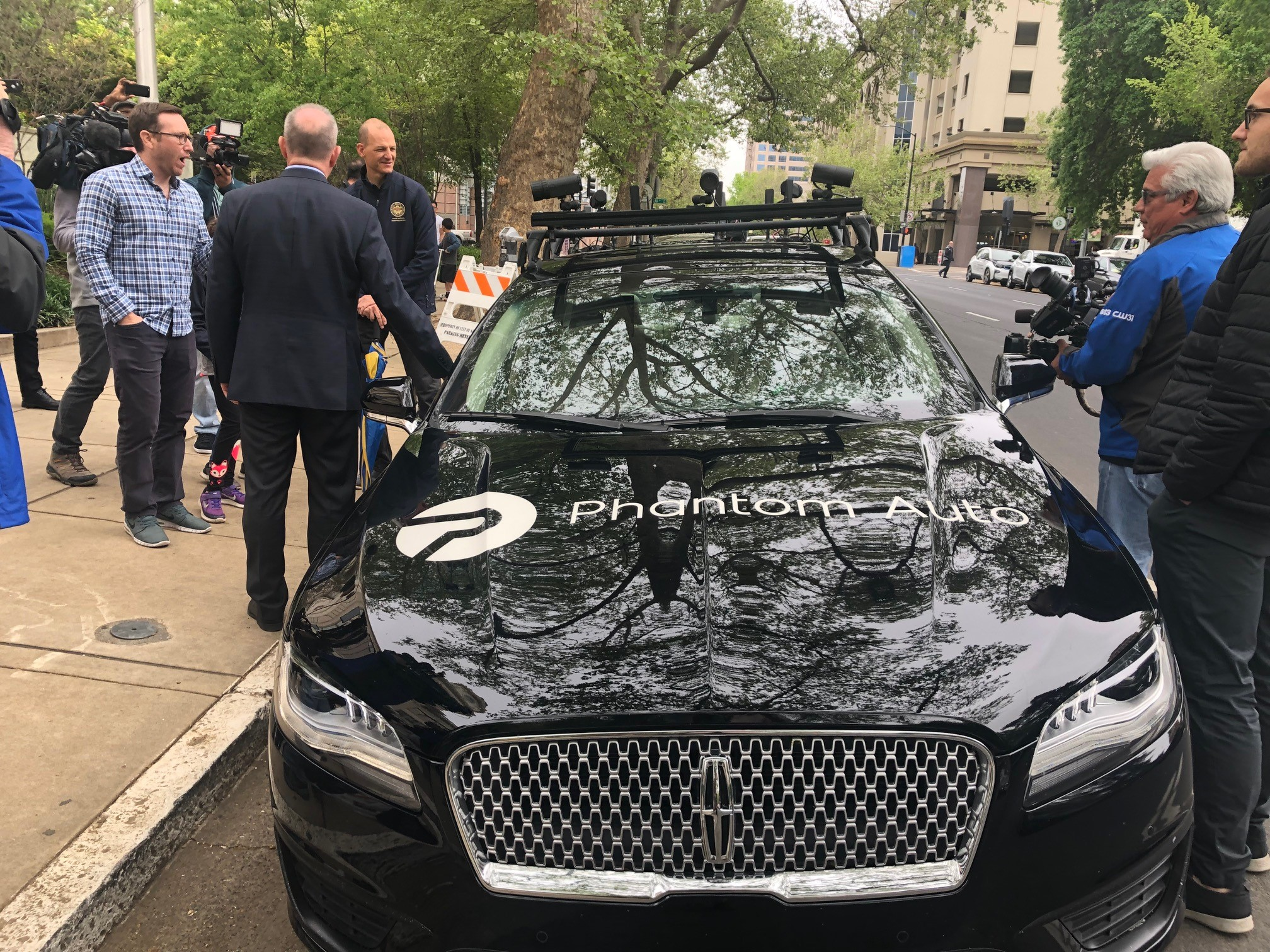 The Phantom Auto vehicle parked outside City Hall
