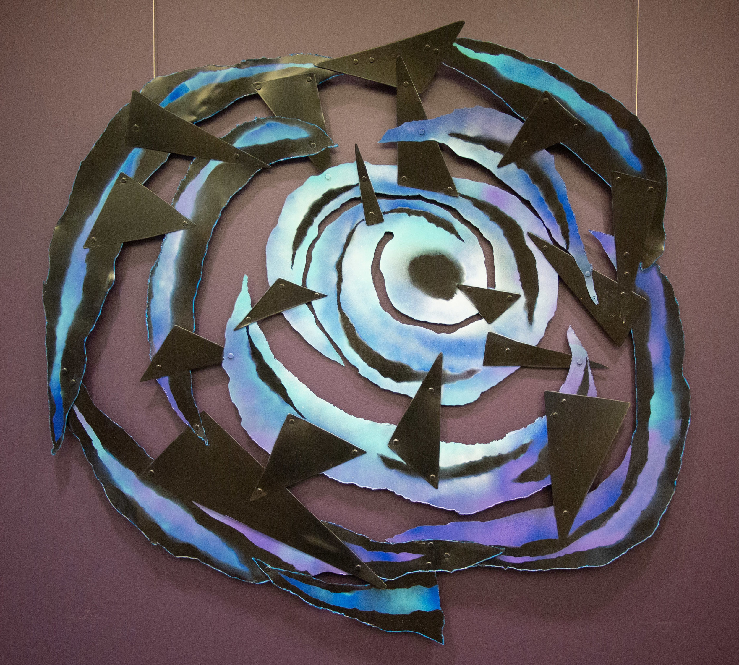 "Swirl and Stability, fused pigment and paint on metal, 42""x45""x1"""